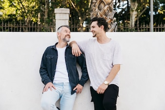 Father and son in front of wall