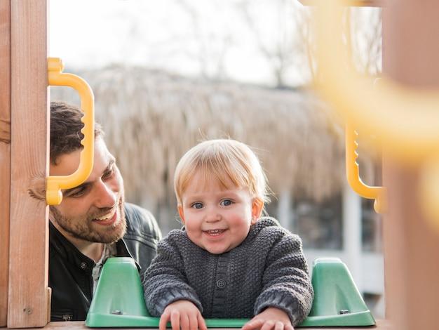 Отец и сын на детской площадке