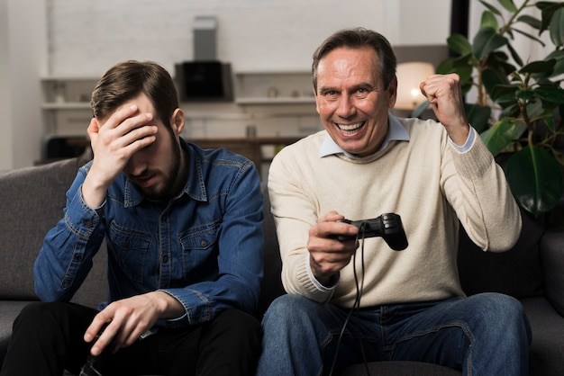 Father beating son at videogames