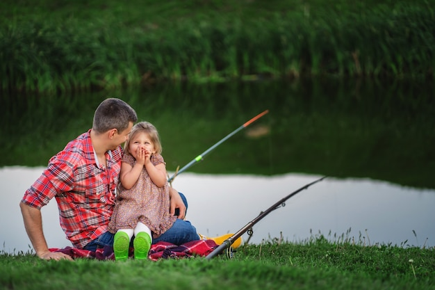 Father and daughter are fishing