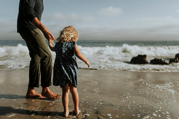Father and daughter at a beach