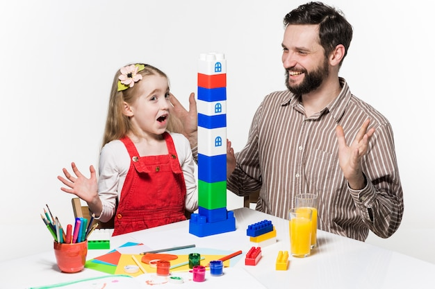 Father and daughter playing educational games together