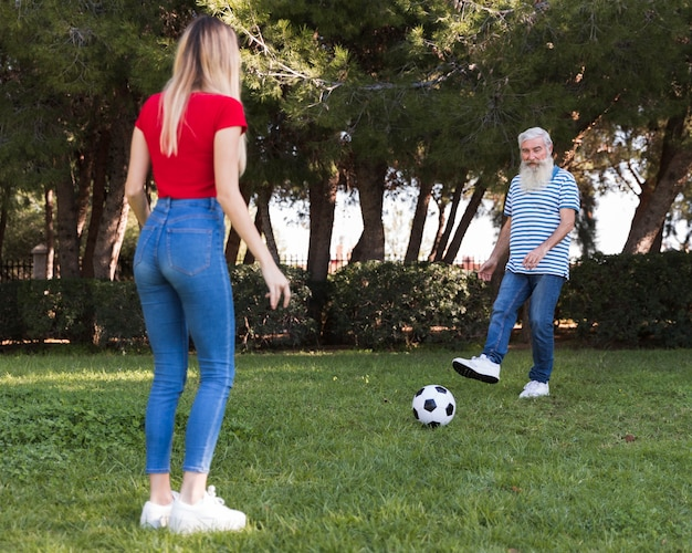 Father and daughter playing soccer