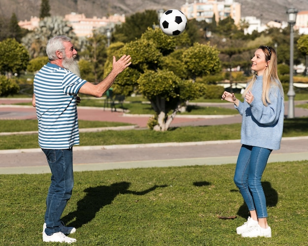 Father and daughter playing with ball