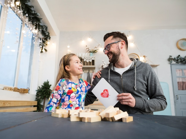 Father and daughter playing with wood blocks