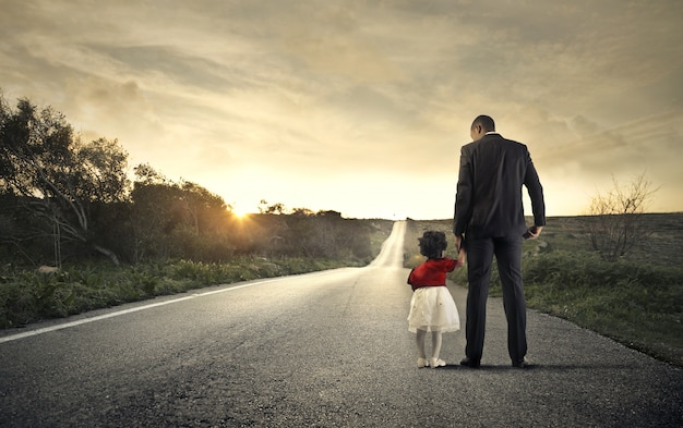 Father and daughter on the road