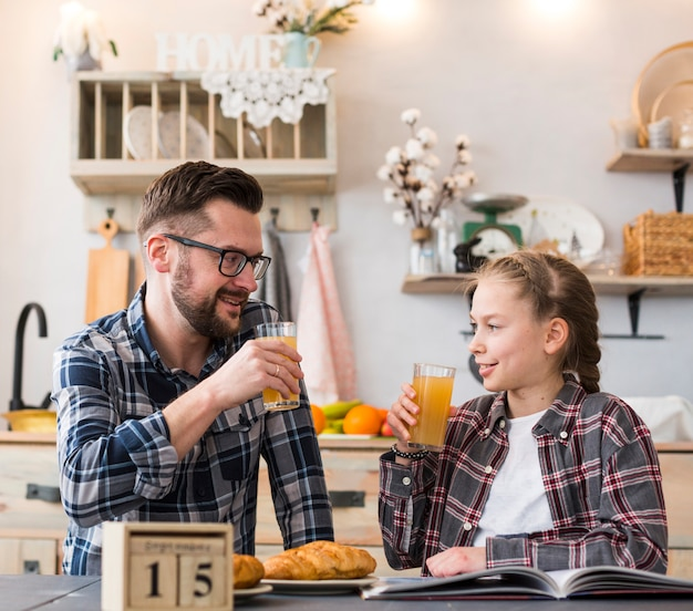 Father and daughter together on breakfast table
