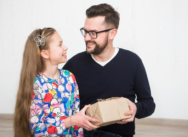 Father and daughter with gift box