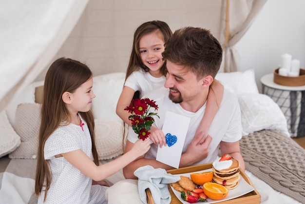 Father and daughters having breakfast on fathers day
