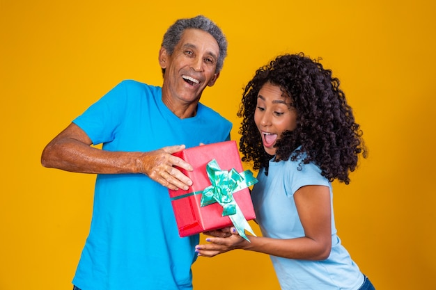 Father giving a present to his daughter for children's day