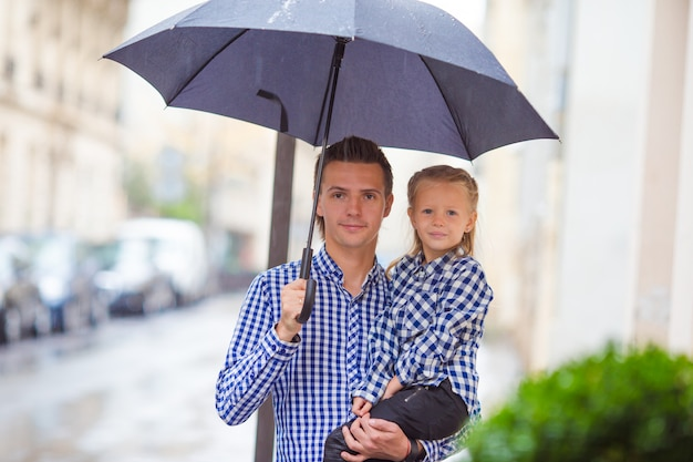Father and his little daughter outdoors in european city
