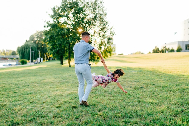 Father holding his daughter in the park