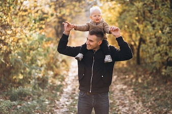 Father holding his son in park