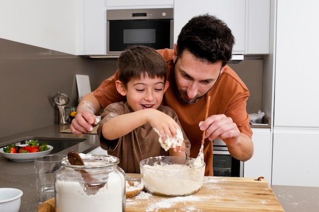 Father and kid cooking together
