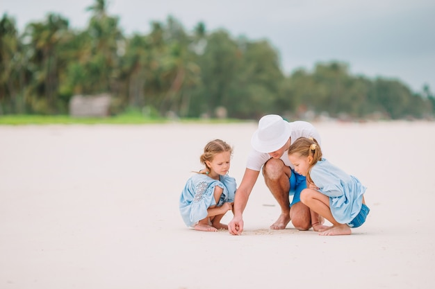 Father and kids on the beach