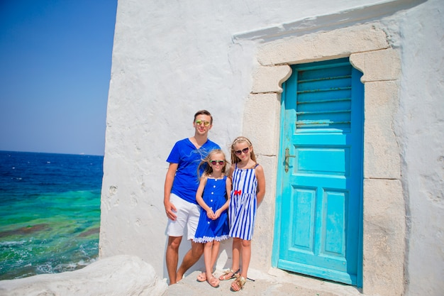 Father and kids in mykonos town in greece