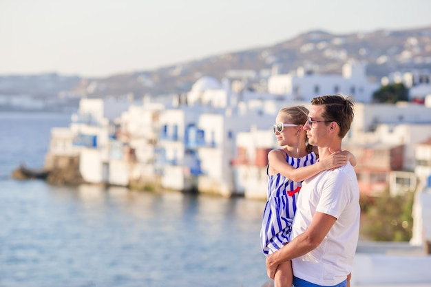 Father and little girl in little venice in mykonos