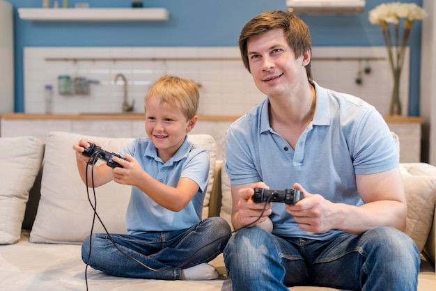 Father playing video games together with son