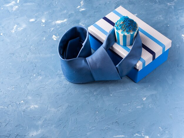 Father's day card with gift box and cup cake, tie