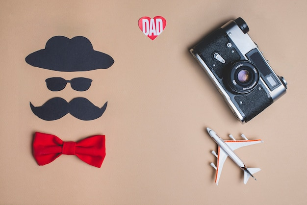 Father's day composition with decorative red bow tie