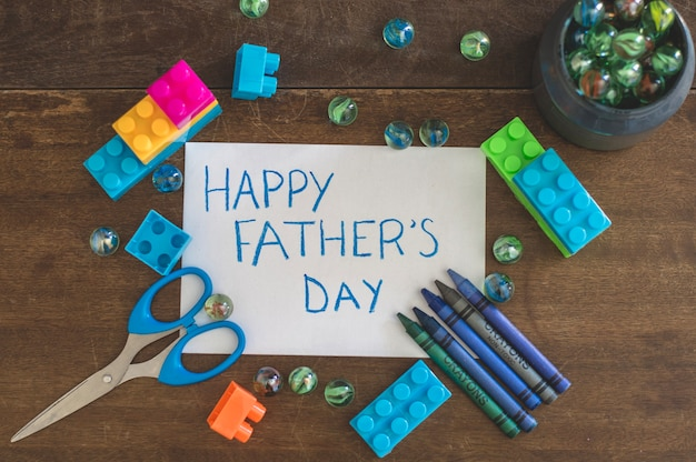 Father's day composition with scissors and toys