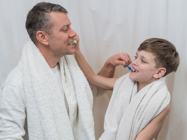 Father's day dad and son brushing each other teeth