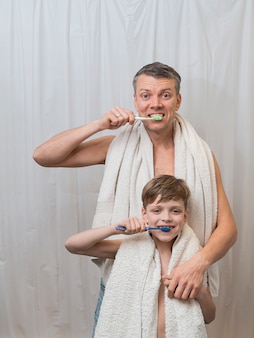 Father's day dad and son brushing their teeth