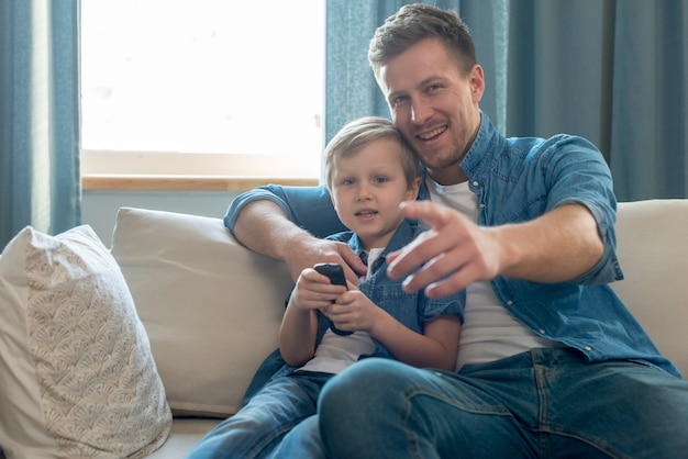 Father's day dad and son watching the tv