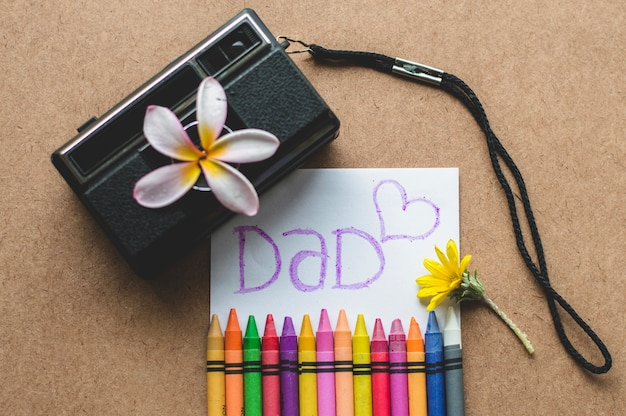 Father's day decoration with vintage camera and crayons