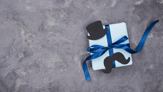Father's day gift with ribbons minimalist concept