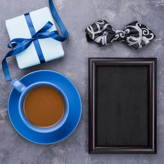 Father's day gifts with empty frame and cup of coffee
