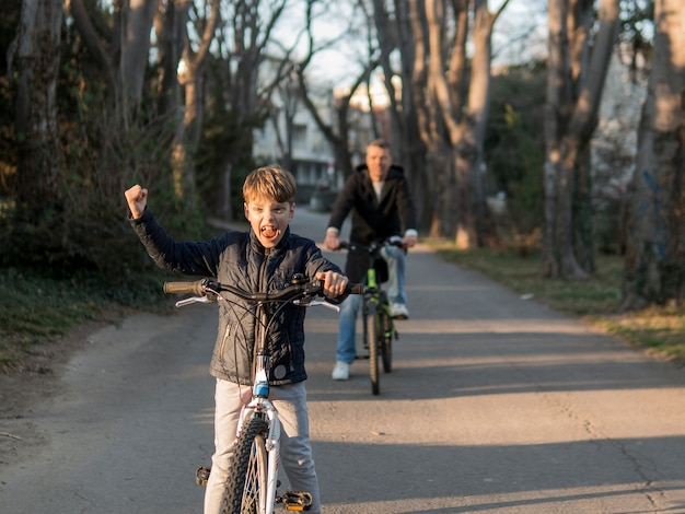Father and son on bikes in the park