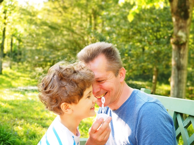 Father and son blow bubbles