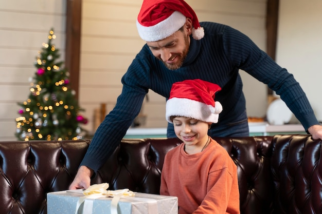 Father and son celebrating christmas at home