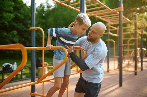 Father and son doing exercise, sport training