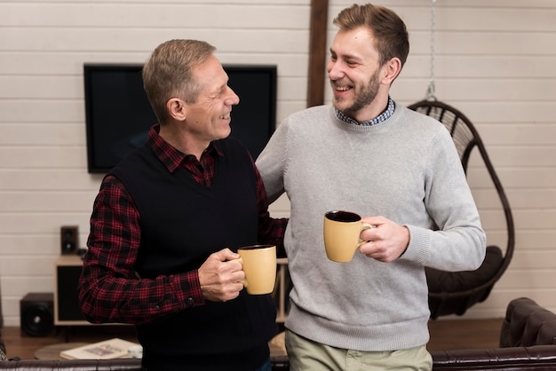 Father and son enjoying coffee together