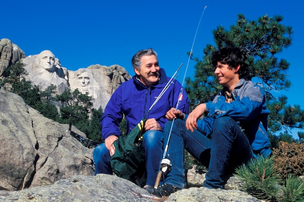 Father and son fishing, mt. rushmore, south dakota