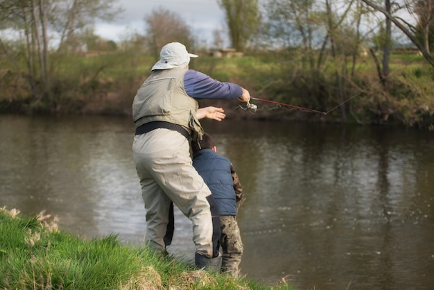 Father and son fishing on the river