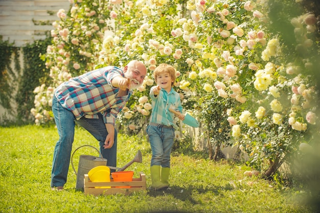 Father and son grows flowers together gardening hobby farm family spring and hobbies