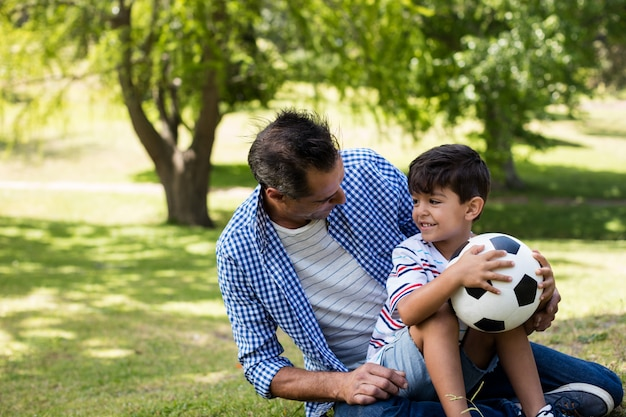 Father and son interacting with each other in park