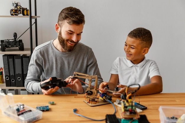 Father and son making robot
