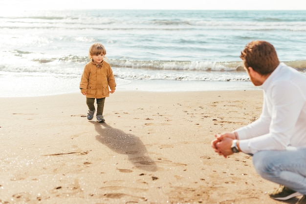 Father and son near sea