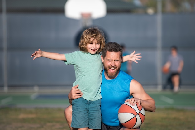 Father and son playing basketball. concept of healthy holiday and family activity.