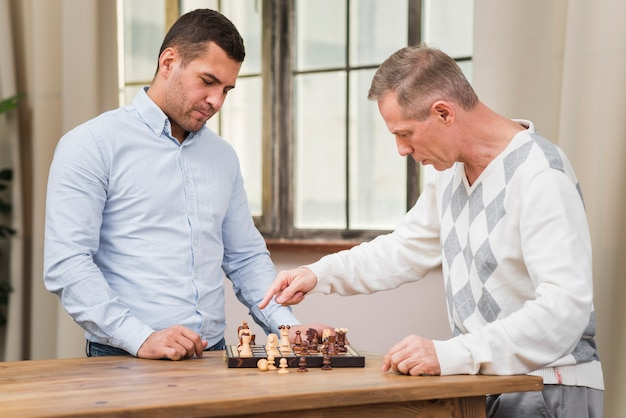 Father and son playing a chess match