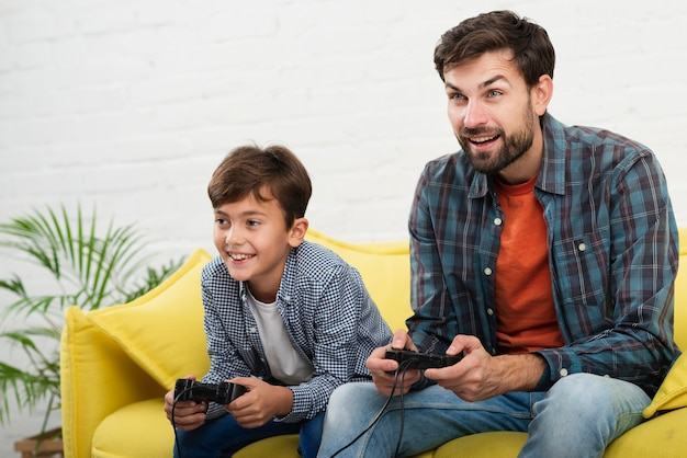 Father and son playing on console