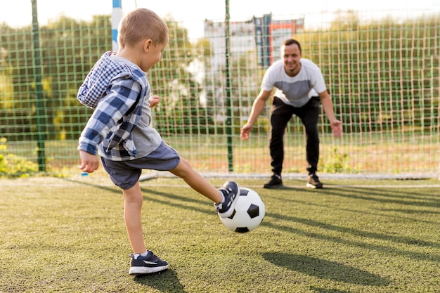 Father and son playing football