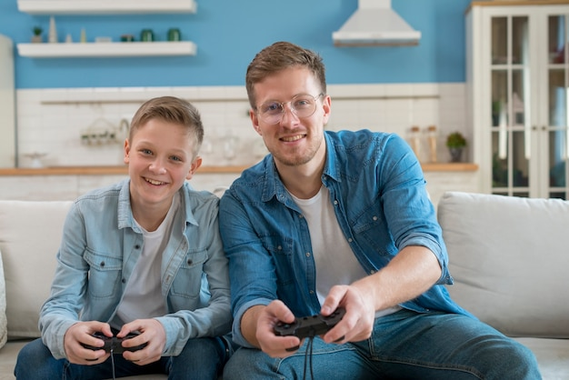 Father and son playing video games with controllers