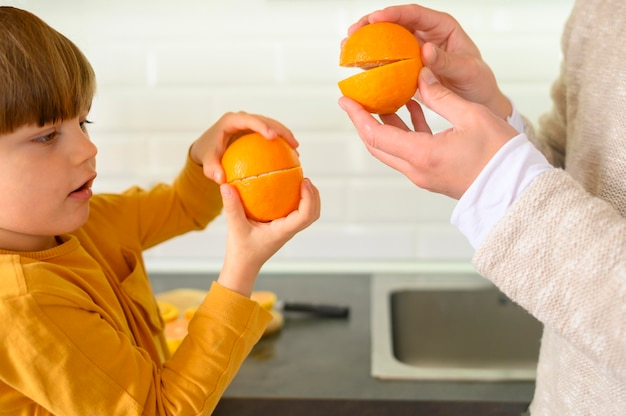 Father and son playing with oranges