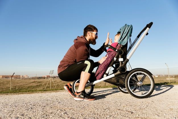 Father and son running in the park. family and sport concept.