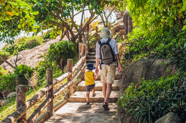 Father and son travelers at the hon chong cape, garden stone, popular tourist destinations at nha trang. vietnam